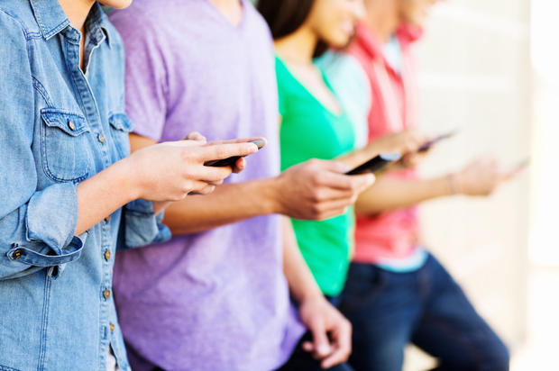 Friends Text Messaging Through Smart Phone