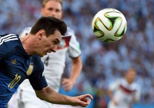Argentina's forward Lionel Messi heads t