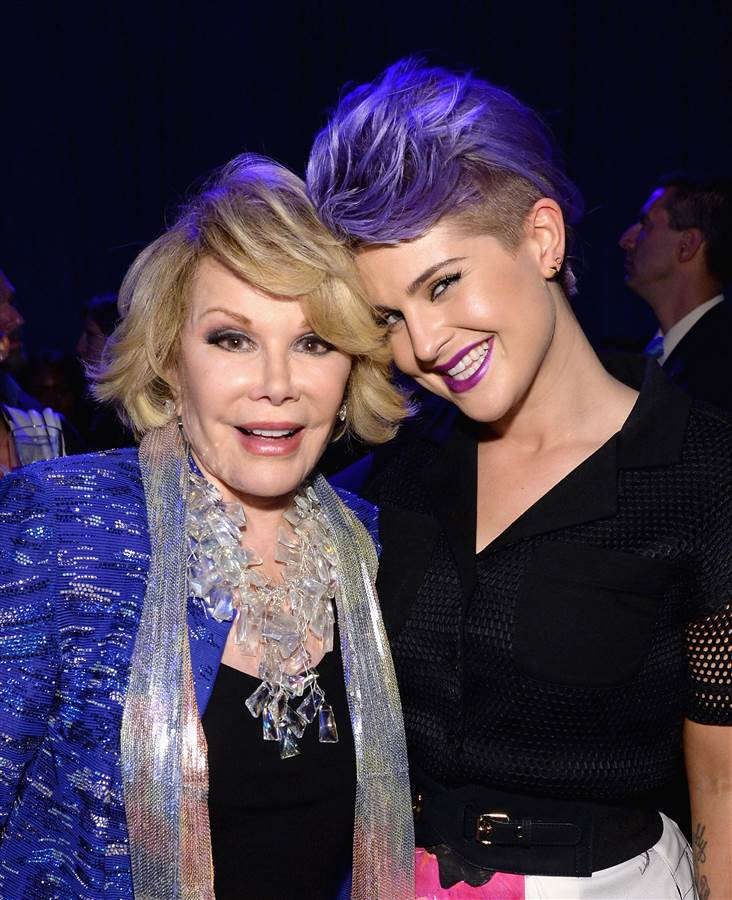 "Joan Rivers and Kelly Osbourne are hosted by ""Fashion Police"" they pose at an event in New York in May 2014."