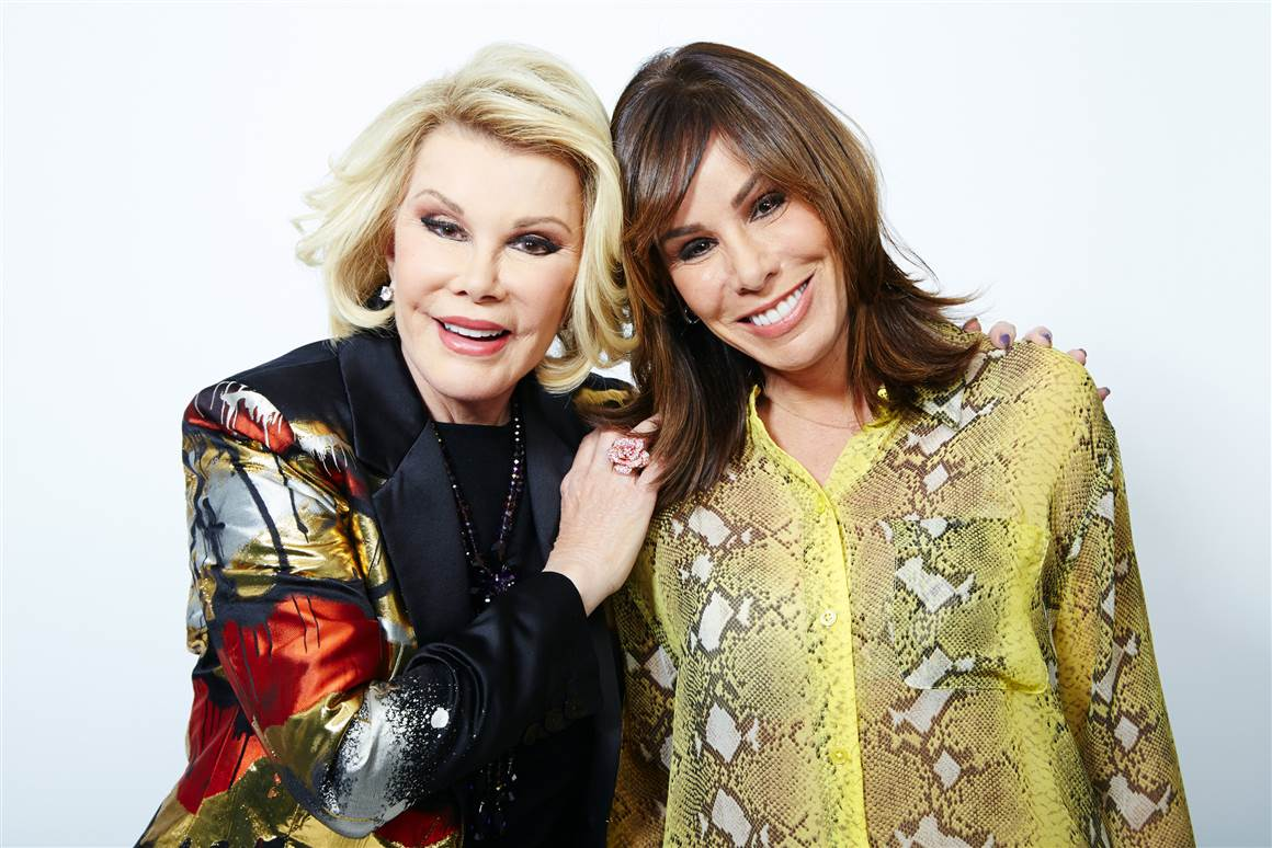 Joan Rivers poses with her daughter Melissa Rivers in 2013.