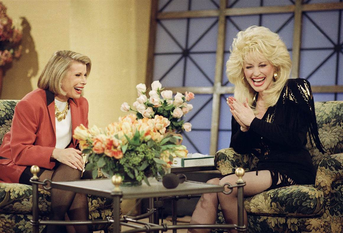 "Dolly Parton appears on ""The Joan Rivers Show"" in 1993."