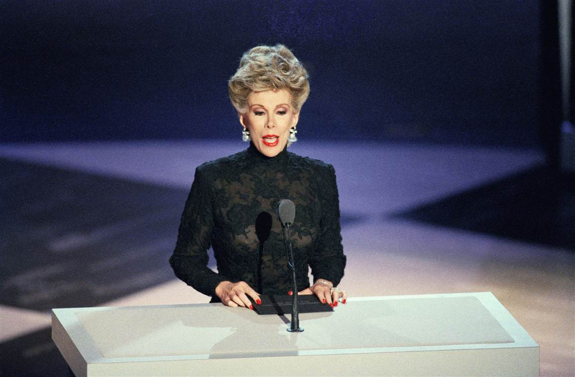 A subdued Joan Rivers makes her first television appearance since the August death of her husband in Pasadena, Calif., during the 39th Annual Emmy Awards at the Pasadena Civic Auditorium, on Sept. 21, 1987.
