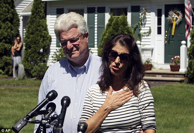 Diane and John Foley talk to reporters