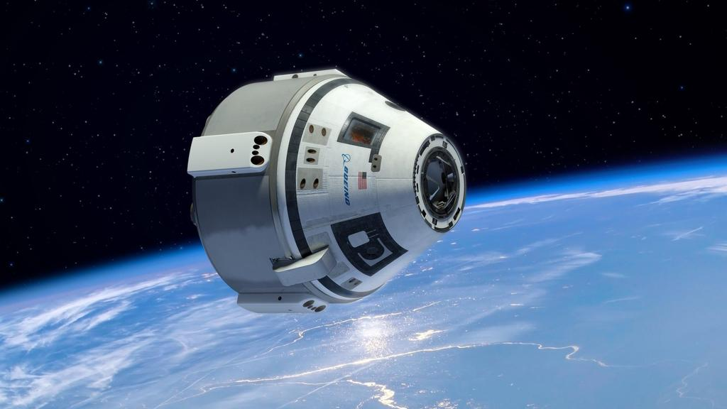 nasa-picks-boeing-spacex-to-build-space-taxis1410937708
