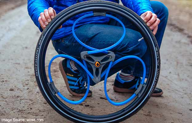 shock-absorbing wheel for wheelchairs