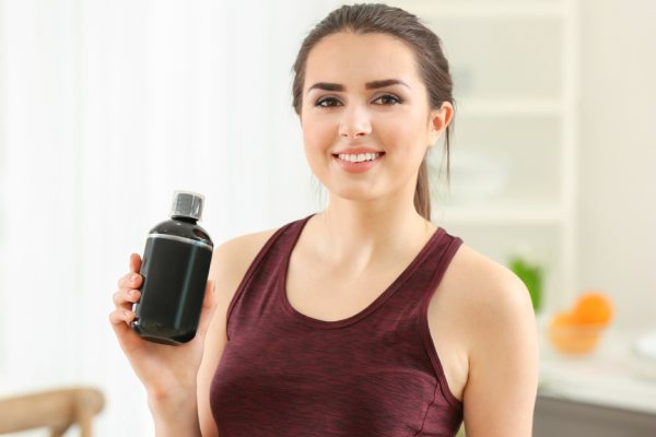 Beautiful Young Woman Sport Supplement