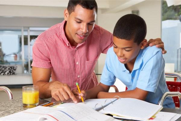 Father Helping Son Homework Kitchen