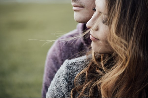 Young Loving Couple Outdoors Sitting